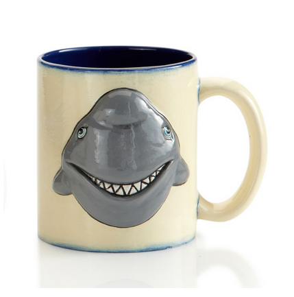 Shark Pencil MugShark Pencil Mugs - These mugs are not food safe and should not be used for food or drink. Supplies: 1 Ceramic mug 1 Tub of Black 1 Tub of White 2 Tubs of Blue You may opt to use your own paint colors. To maintain the paint colors you should seal the artwork with a spray sealer. Steps: Mixing Paint Colors Reserve a little black and paint for eyes and teeth. Mix black and white paint to make gray. To lighten blue, add white. (optional) To darken blue, add black. (optional) Paint the shark head and tail gray. Paint the eyes and teeth white. Paint a black circle for the pupil. Paint a blue outline around the pupil. Put a white dot in the black circle of the eye. Outline the teeth with black. Paint the rest of the mug blue inside and out. **If paint is dry, just add a little water!**